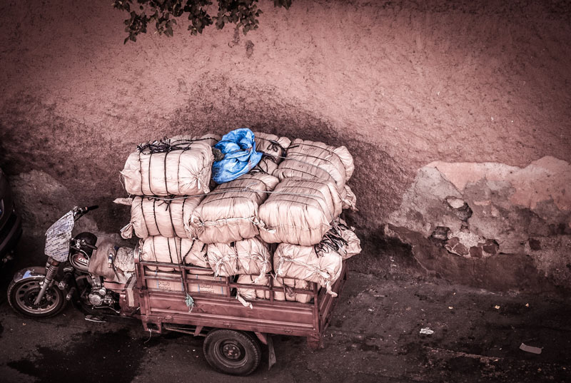 Image of bundles being carried in a cart.