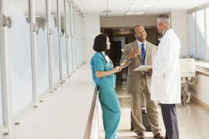 health care professionals in hospital hallway