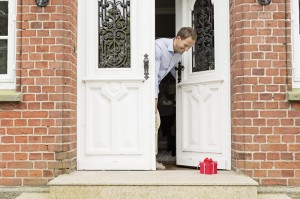 small, wrapped gift on door step