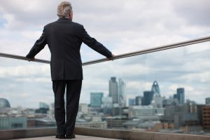 Man in suit overlooking city landscape