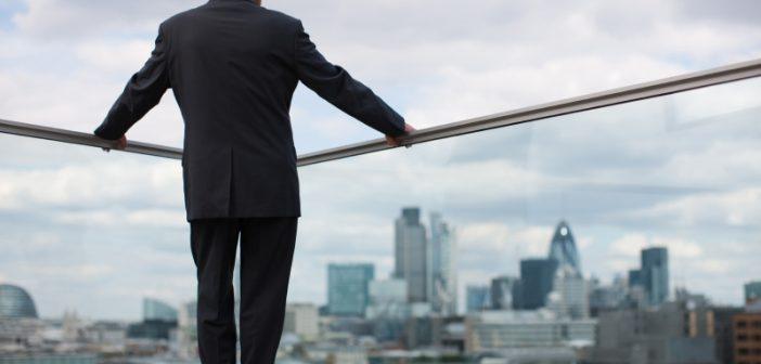 Man in suit overlooking city landscape