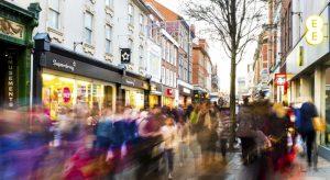 Blurry people walking on city street