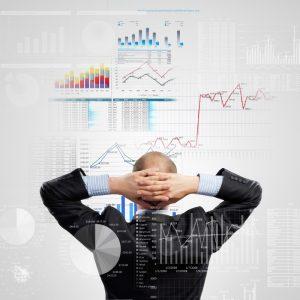 Man looking at charts on wall