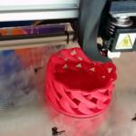 3D printer printing a test print