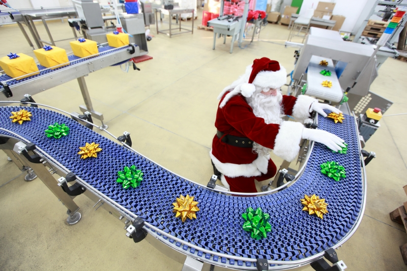 Santa working on gift wrapping assembly line