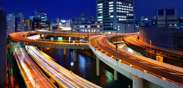 Modern freeway lit up at night