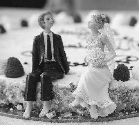plastic bride and groom on a wedding cake