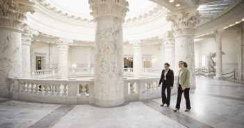 two politicians walking in government building