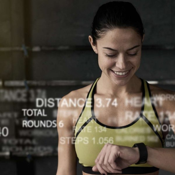 Woman in sports clothes looking at watch