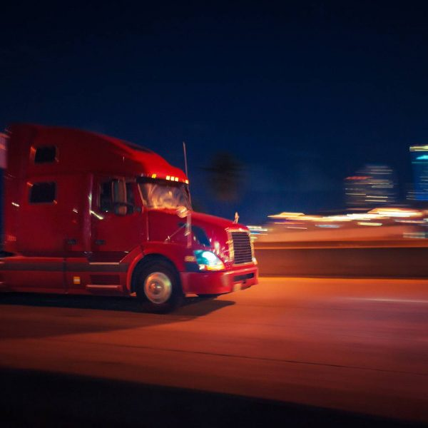 semi truck driving at night