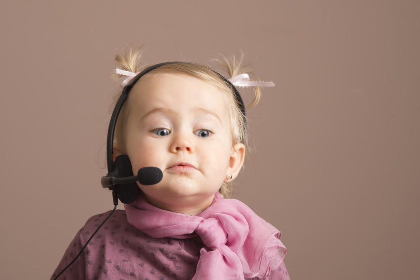 Funny baby on the phone as an operator