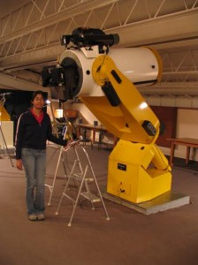 "Juthika Khargaria, Ph.D. in Astrophysical and Planetary Sciences from University of Colorado, standing next to the 18"" telescope at Sommers Bausch Observatory."